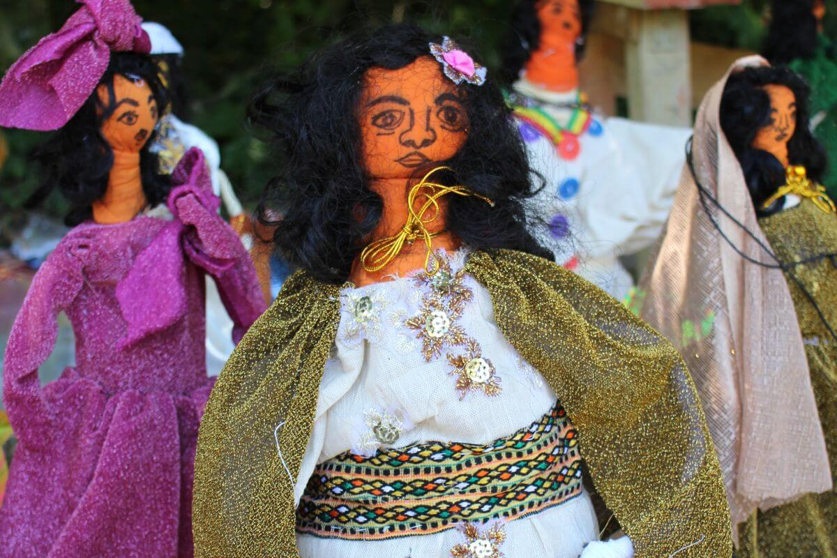 Children make imaginative dolls from scraps of fabric.